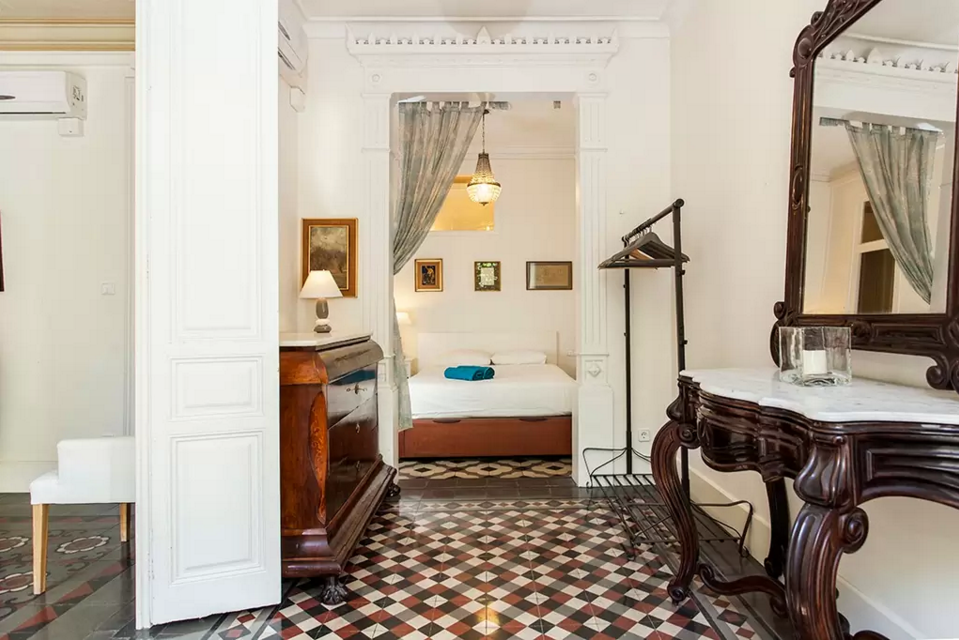Rambla Catalunya 113.  Perfectly located on Rambla Catalunya, just one street away from the infamous Passeig de Gràcia, this is a quintessentially Spanish apartment. With its authentic tiled floors,antique furniture,copious communal space and bright and airy bedrooms, this apartment is perfect for families, friends and business trips alike.   Book now with airbnb!