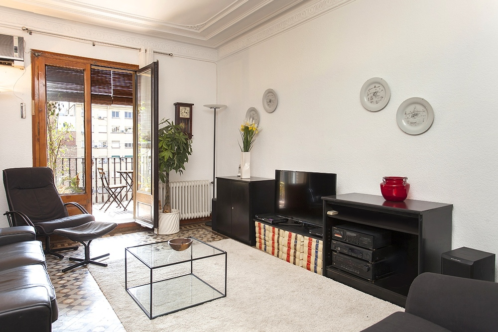 Valencia.  Located in chic Eixample Dreta, this apartment is a delightful fusion of modern convenience and eclectic Spanish detailing. Complete with an 8sqm terrace, this light and spacious apartment is perfect for groups of up to 10 people.   Book now with airbnb!