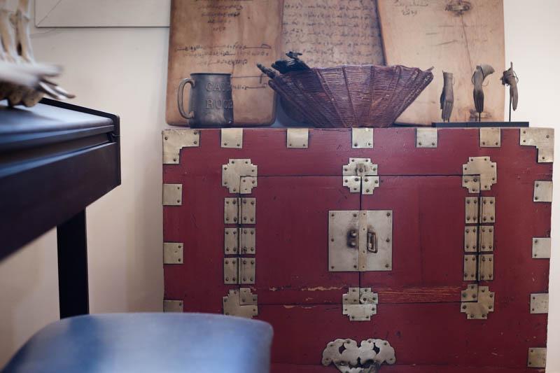 Korean wedding chest, Koranic school boards, Thai Buddha hands (Interior design at Peacock Pavilions - MyMarrakesh, M.Montague)