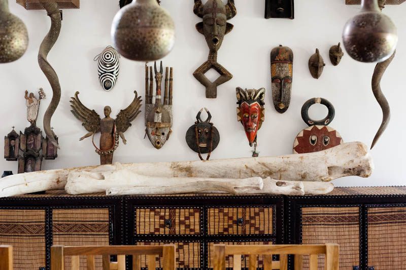 African masks, whale ribs, custom console made from nomadic reed & leather mats (Interior design at Peacock Pavilions - MyMarrakesh, M.Montague)