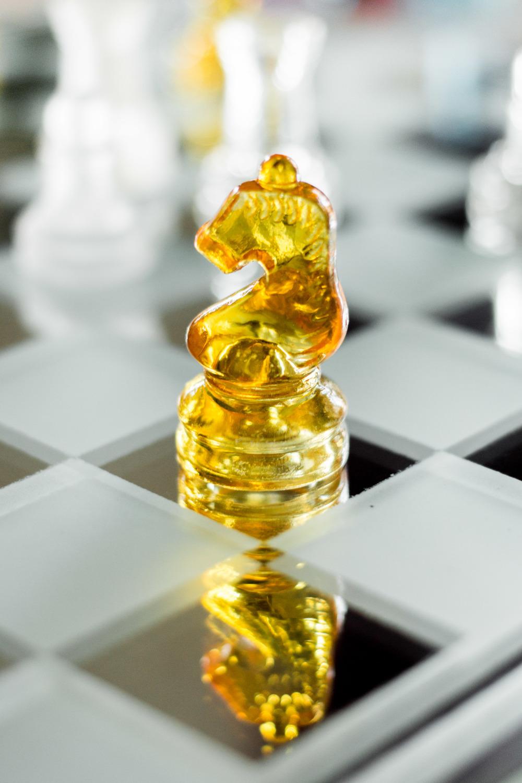 gold chess piece knight