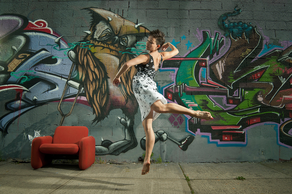 Portrait photograph of female dancer jumping