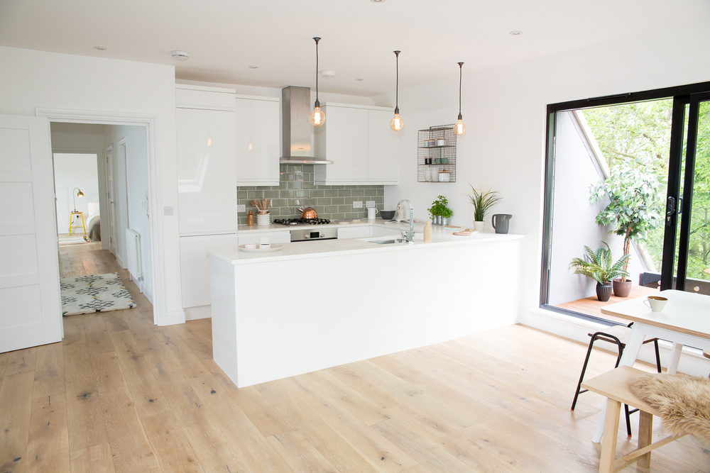 And from the other angle, the spacious kitchen with gorgeous eddison bulbs and metro tiles.