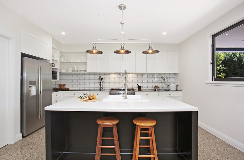 Vintage / Industrial Kitchen, polished concrete floors with white 200x100 subway tiles and graphite grey grout.