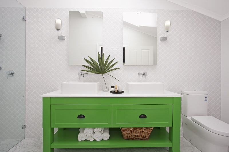 Custom made kelly green vanity with stone top, Carrara marble floor tile, lantern wall tiles, Shaving Cabinets and Phoenix tapwear.