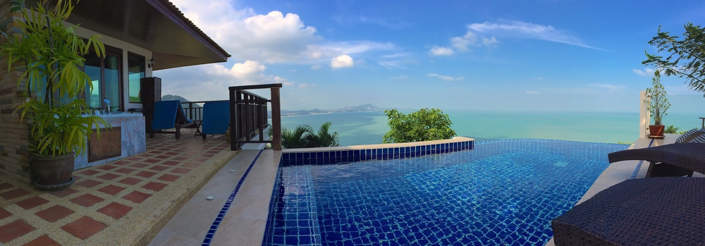 A panorama of the outdoor jacuzzi and infinity pool