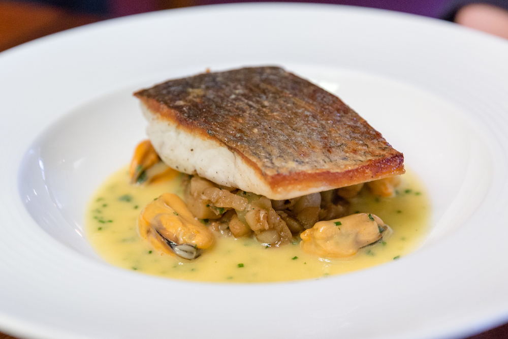 Fillet of Stonebass, Crushed Jerusalem Artichokes, Cider Butter Sauce and Mussels