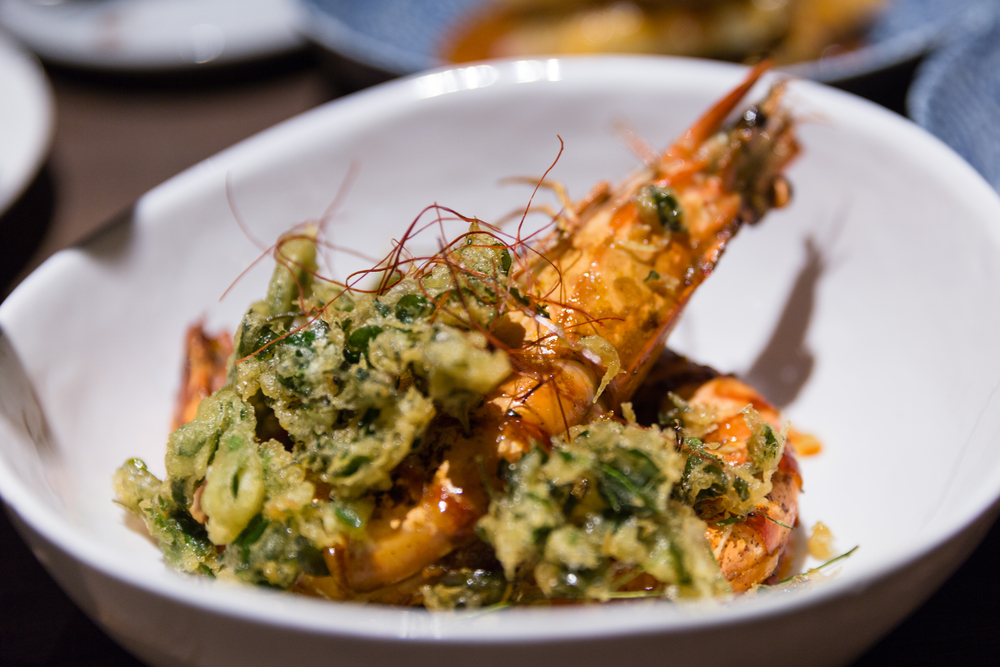 Grilled Aromatic King Prawns, Dry Red Curry, Thai Basil, Green Peppercorn, Tempura of Moringa Leaf