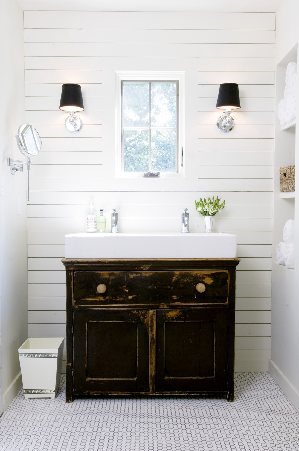Farmhouse bathroom with white plank wall and distressed black vanity.  Designed by David Anderson Architect | Friday Favorites at www.andersonandgrant.com