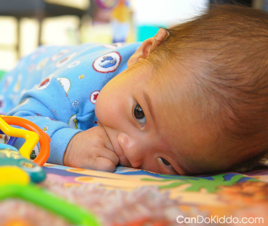 The Value of Hand To Mouth and other hidden benefits of Tummy Time for newborns. CanDo Kiddo