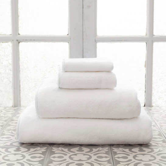 Annie Selke has several lines that offer linens and towels. These are from Pine Cone Hill, and there are several options, including a whole range of color accents. A great option for a white towel with just a touch of personality.