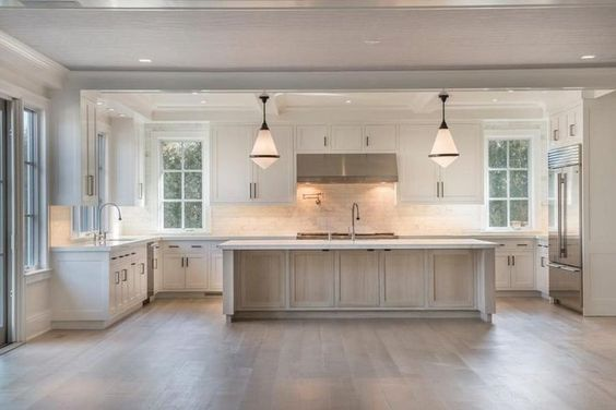 Designed by Michael Davis in Sagaponack, NY, this kitchen was a huge source of inspiration. It has the perfect blend of white and wood for a similar coastal vibe we're going for. | Source:  Curbed
