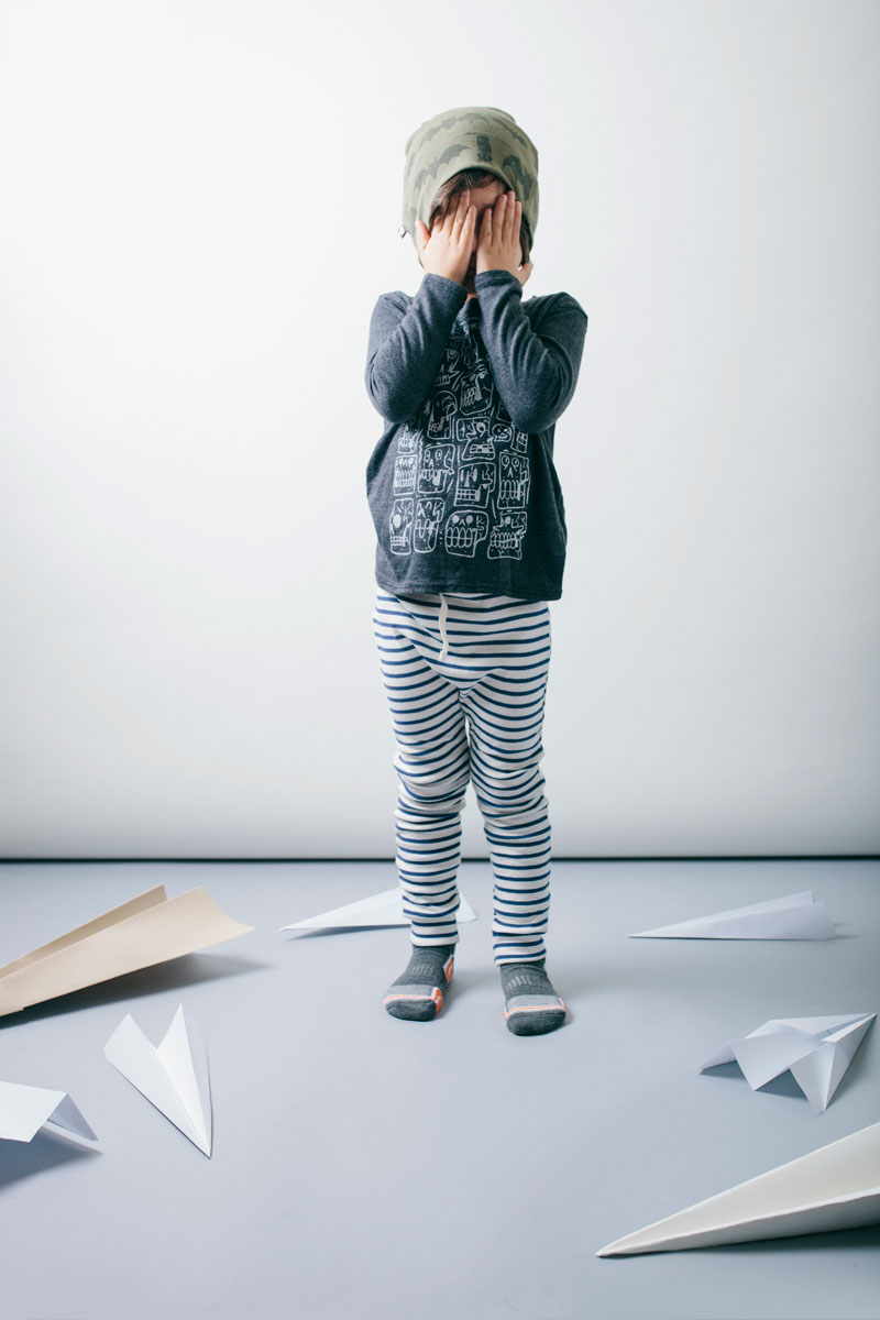 Beanie: Kira Kids. Top: Kira Kids. Pants: Mabo Kids.