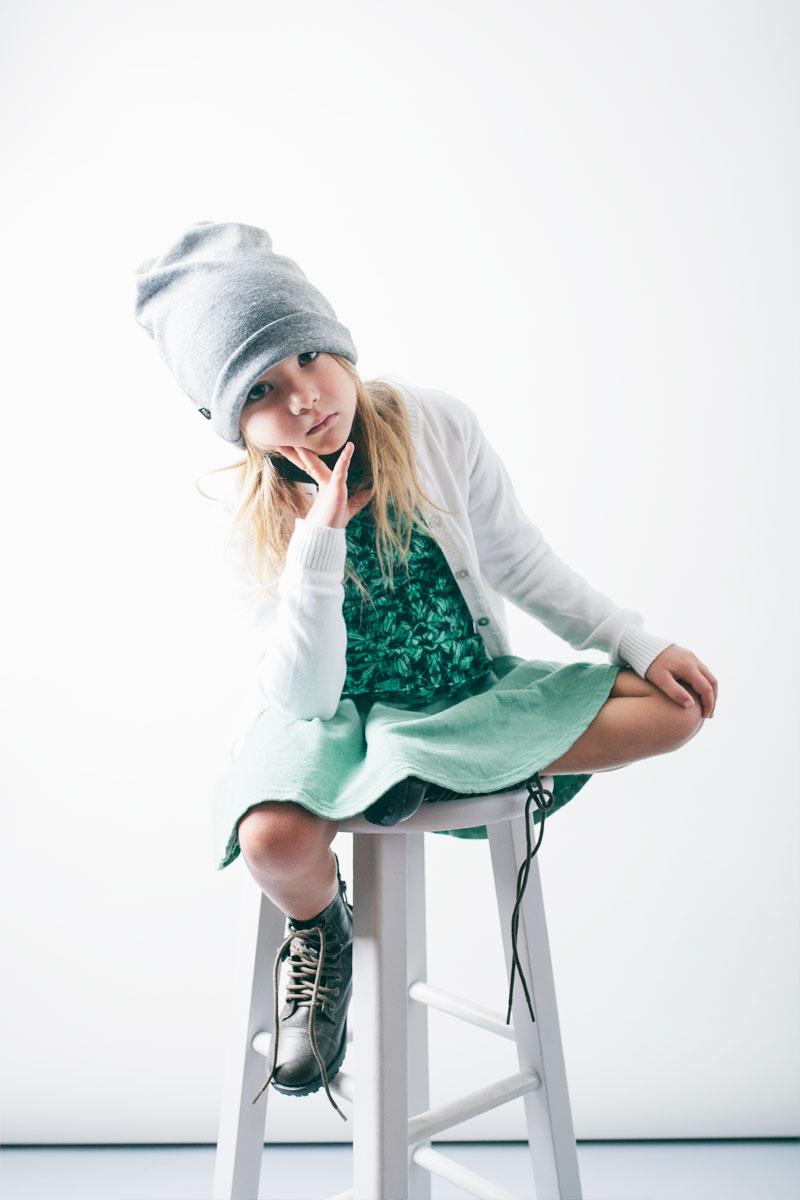 Beanie: Kira Kids. Cardigan: Anjo Kids. Top: Agatha Cub. Dress: Kira Kids.