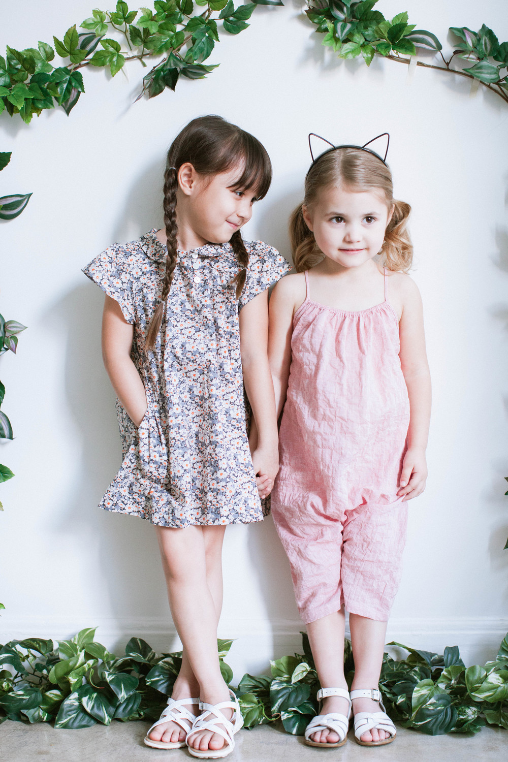 Clementine (left) - Dress: Soor Ploom. Amelia (right) - Romper: Soor Ploom.
