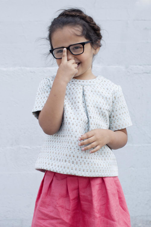Top: Mimosa Kids. Skirt: Je Suis En CP. Glasses: Jonas Paul Eyewear.