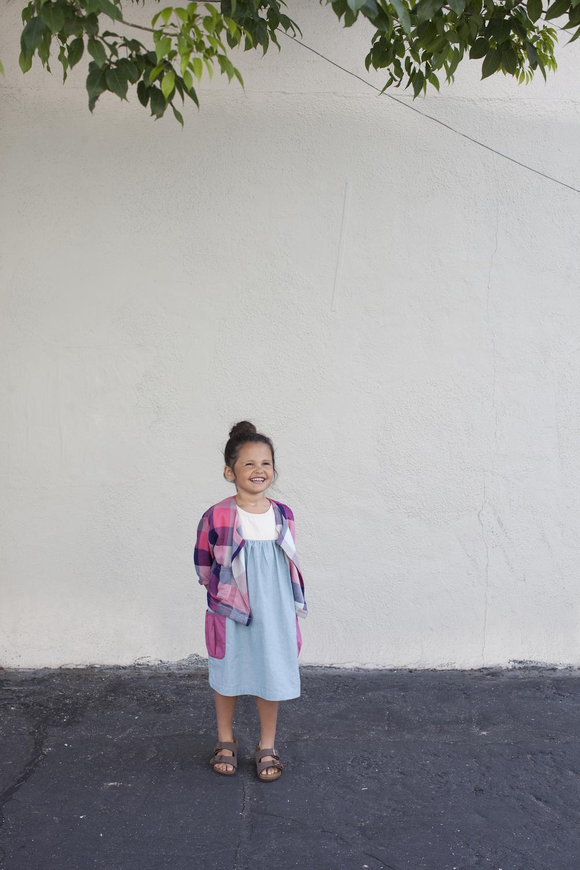 Jacket: Ode to Jeune. Dress: Olive Juice. Shoes: Birkenstocks.