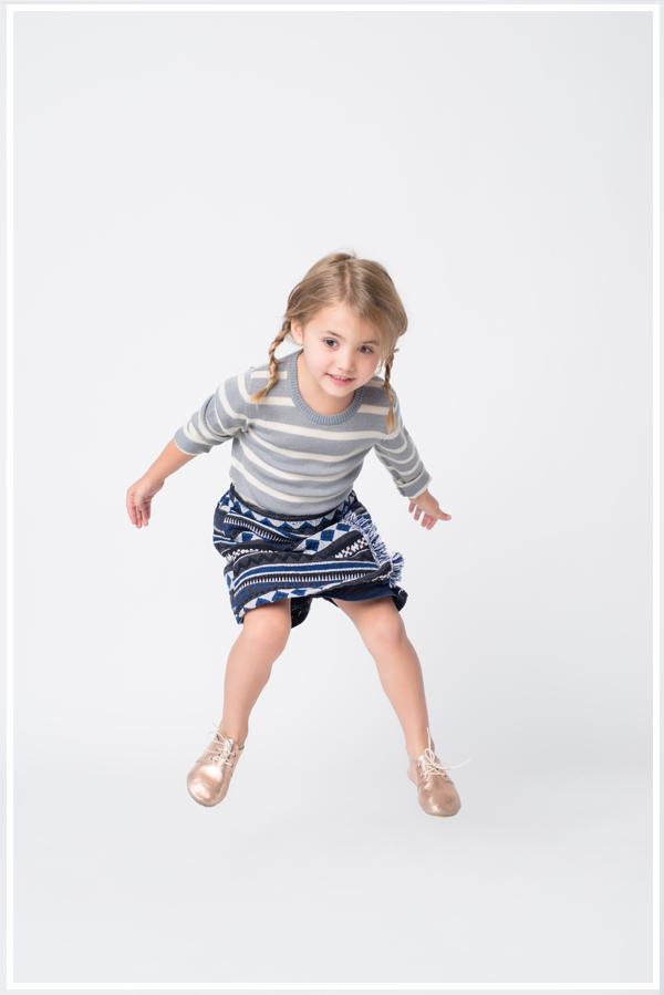 Sweater: Hucklebones. Skirt: Anais & I. Shoes: Zuzii.