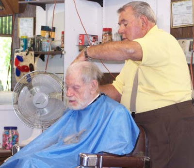 This barber is way too young for this guy.