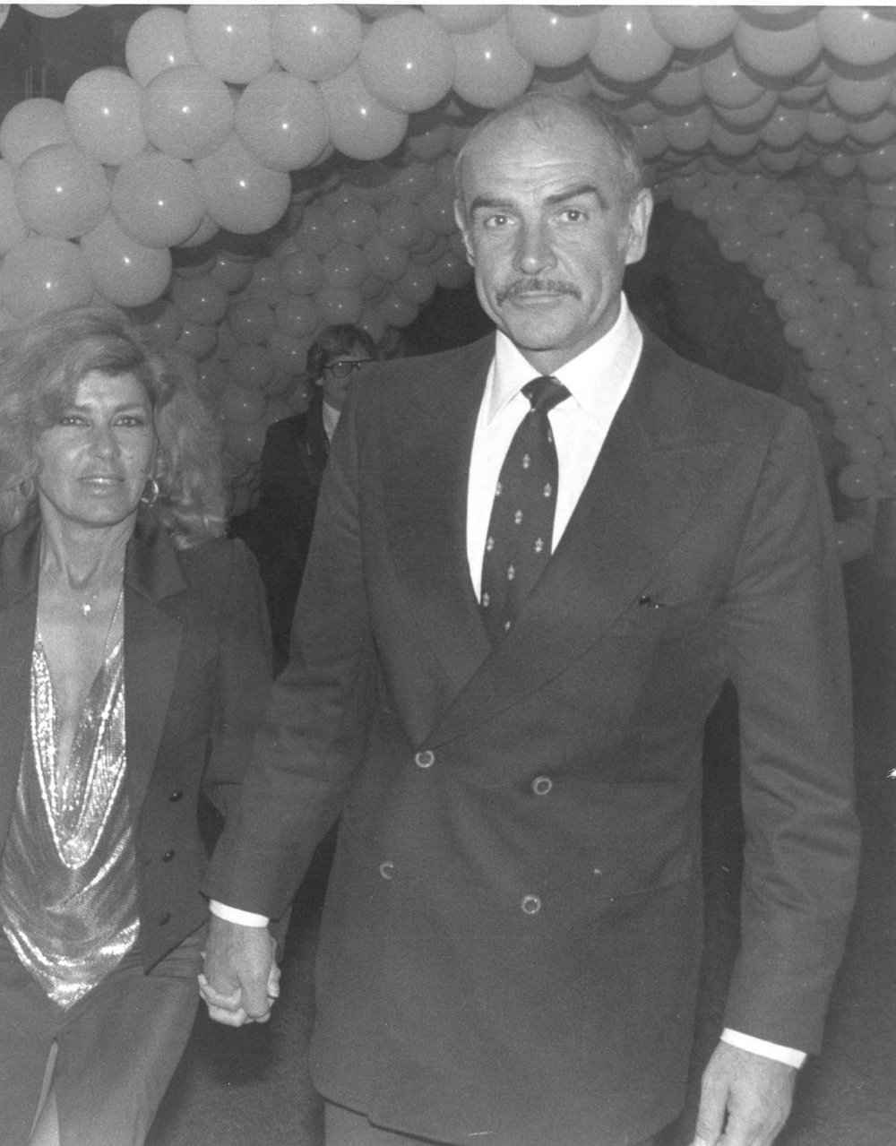 Sir Sean Connery knew how to work a double-breasted suit.