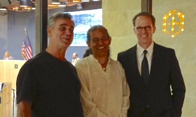 Richard deVarga and Robert Summers pictured with Daniel Llanes, chair of the Govalle-Johnston Terrace Neighborhood Contact Team and head of the neighborhood planning team, in Austin City Hall after the PUD was approval by city council.