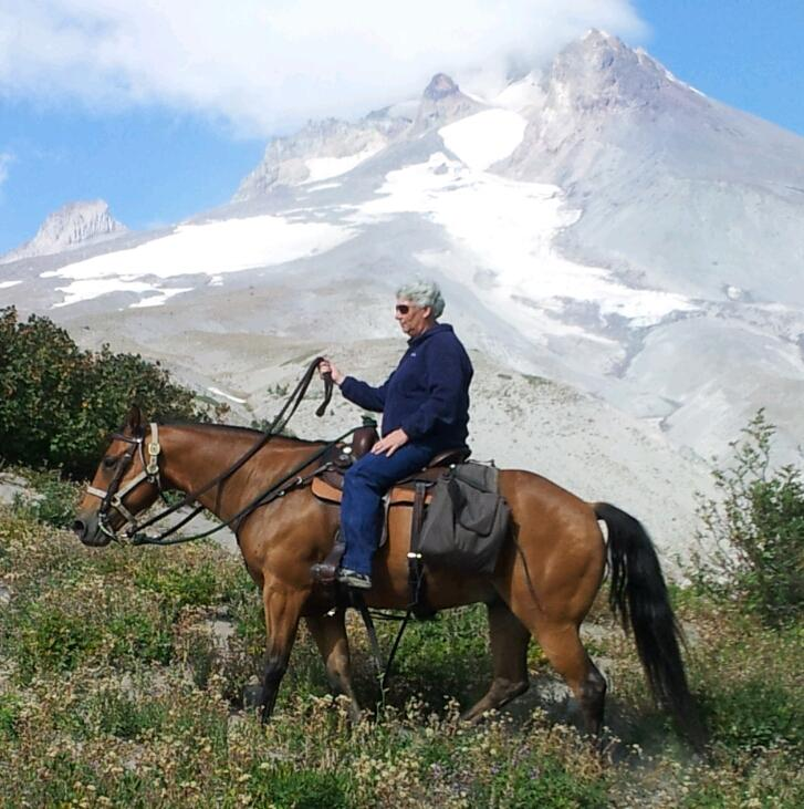 Oregon Equine Assistant Cathy enjoying her Horse Lee on a Mt. Hood trail ride.