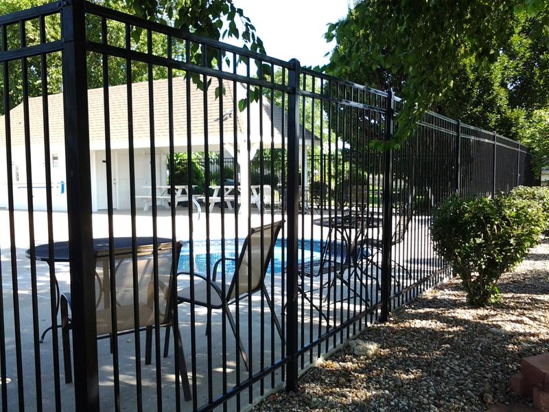 Iron Fence Surrounding Pool