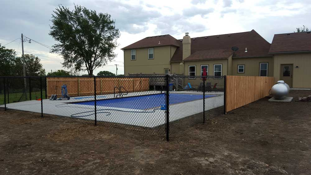 swimming-pool-iron-and-wood-fencing-enclosure-installation---bernies-fence-company.jpg
