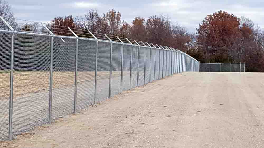 security chain link with bobwire fencing - bernies fence company.jpg