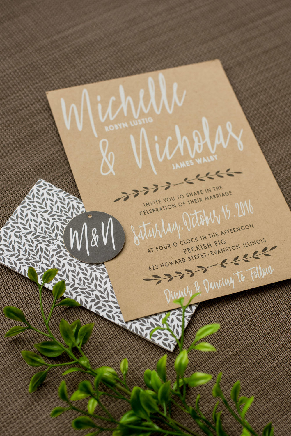 Industrial Chic Wedding Invitation by Ashley Parker Creative on Kraft Paper with Charcoal and Fern Accents, a Monogram Tag, and Printed Bellyband. Main Invite, Bellyband and Tag