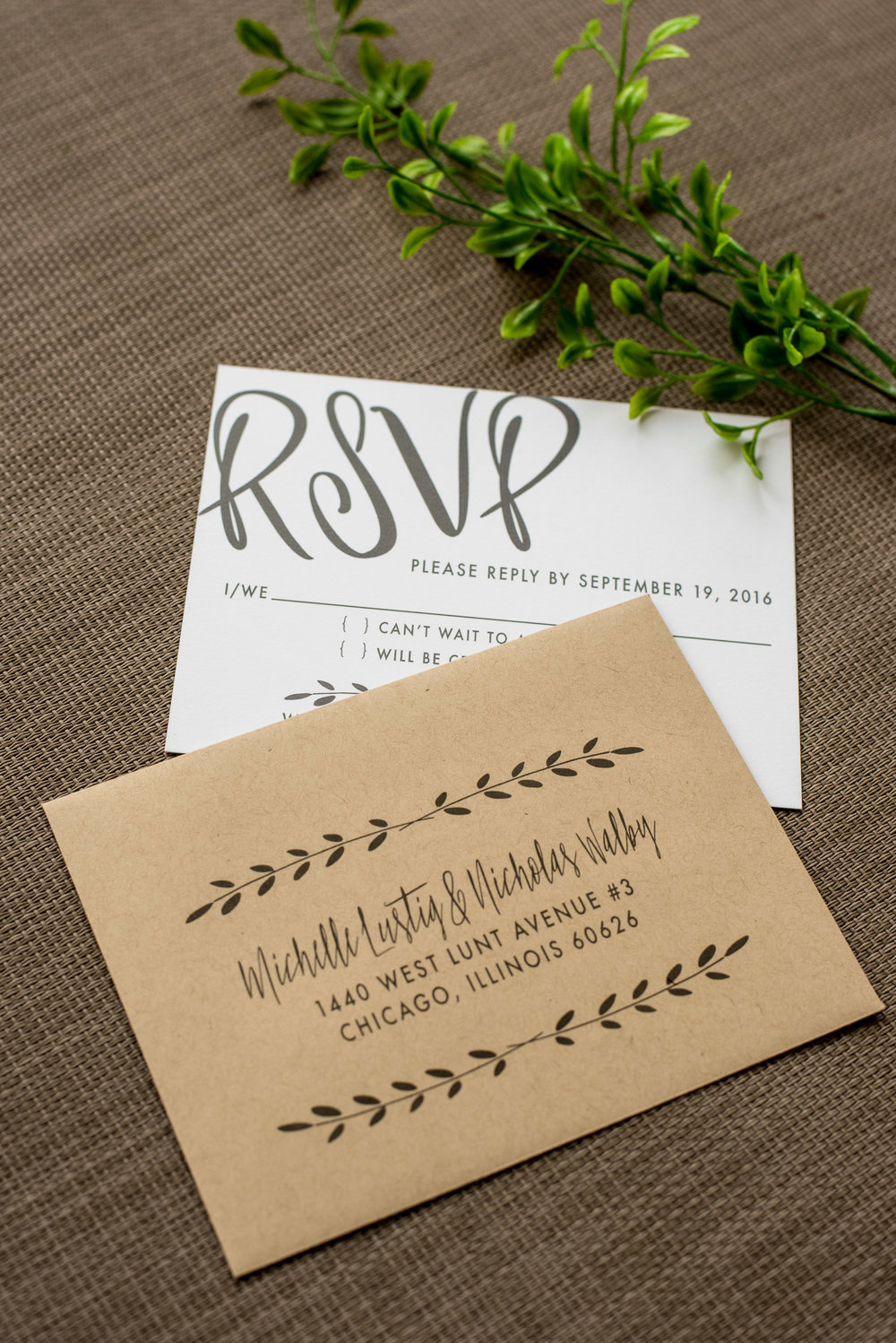 Industrial Chic Wedding Invitation by Ashley Parker Creative on Kraft Paper with Charcoal and Fern Accents, a Monogram Tag, and Printed Bellyband.  RSVP Card and Envelope.