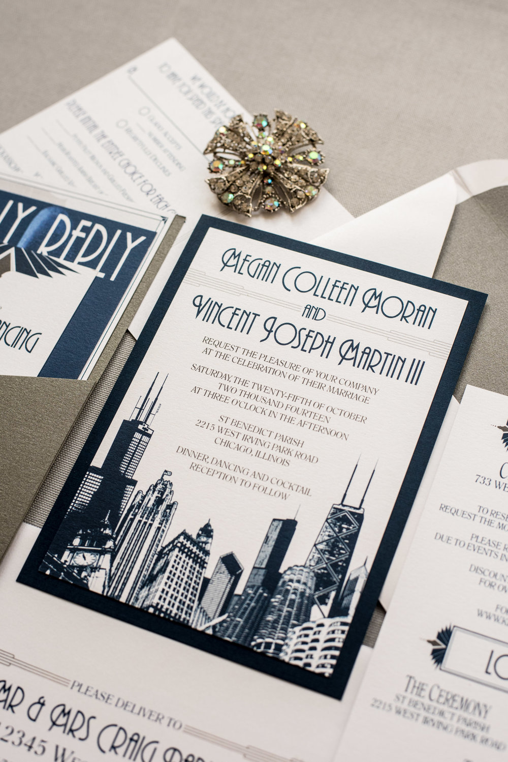 Chicago Wedding Invitation with Skyline, Cityscape, Map, and Fountain with an Art Deco Theme in Navy and Silver in a Pocket Invite by Ashley Parker Creative