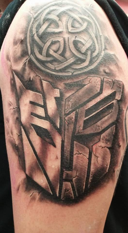 transformers tattoo in stone.jpg