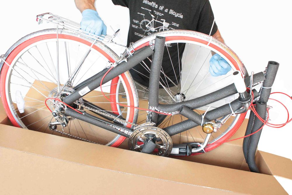 Carefully lift the bicycle out of the box.