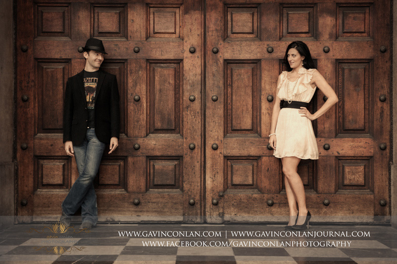 fun fashion portrait outside the main doors of St Pauls Cathedral. London engagement photography by  gavin conlan photography Ltd