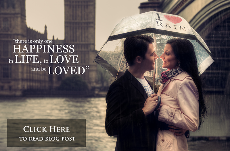 creative fine art couple portrait in the rain under the I heart Rain umbrella with Houses of Parliament in the background. London engagement photography by  gavin conlan photography Ltd