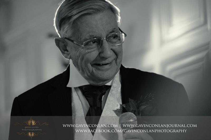 creative black and white portrait of the father of the bride during his speech. Wedding photography at Hengrave Hall by gavin conlan photography Ltd