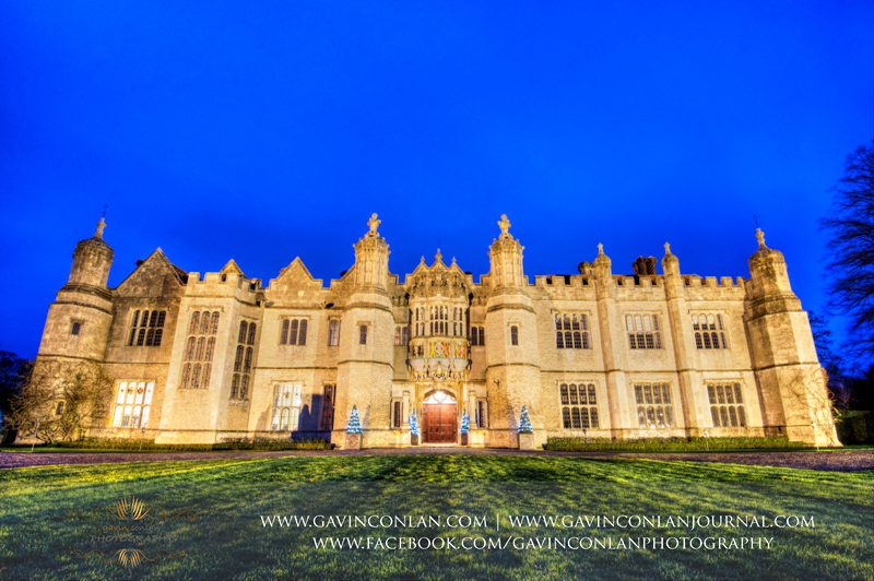 landscape photograph of the exterior of Hengrave Hall at dusk. Wedding photography at Hengrave Hall by gavin conlan photography Ltd