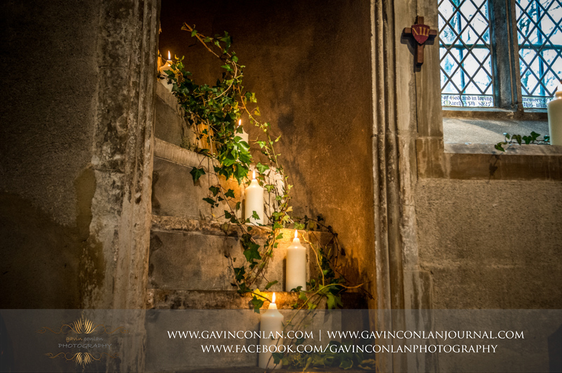 creative detail photograph of candles inside the Church at Hengrave Hall. Wedding photography at Hengrave Hall by gavin conlan photography Ltd