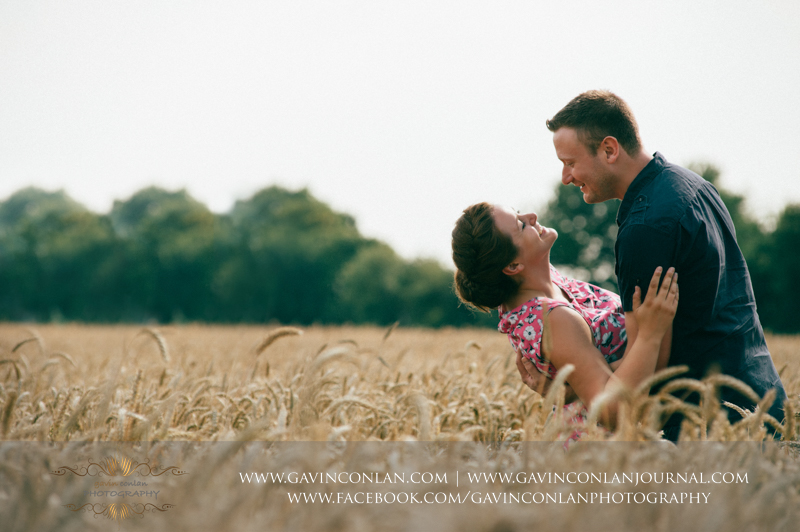 sarah and mark about to kiss in corn field in Essex. Essex engagement photography by  gavin conlan photography Ltd