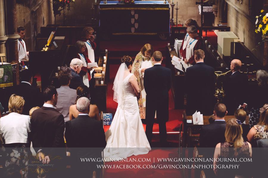wedding ceremony.Wedding photography at All Saints Cranham by gavin conlan photography Ltd