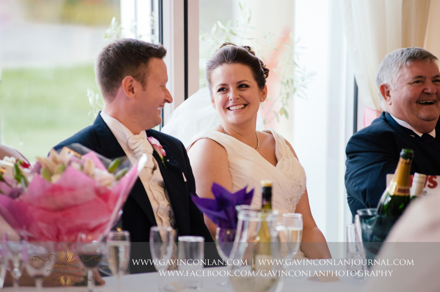 bride and groom laughing at best men speech. Wedding photography at  Moor Hall Venue  by  gavin conlan photography Ltd