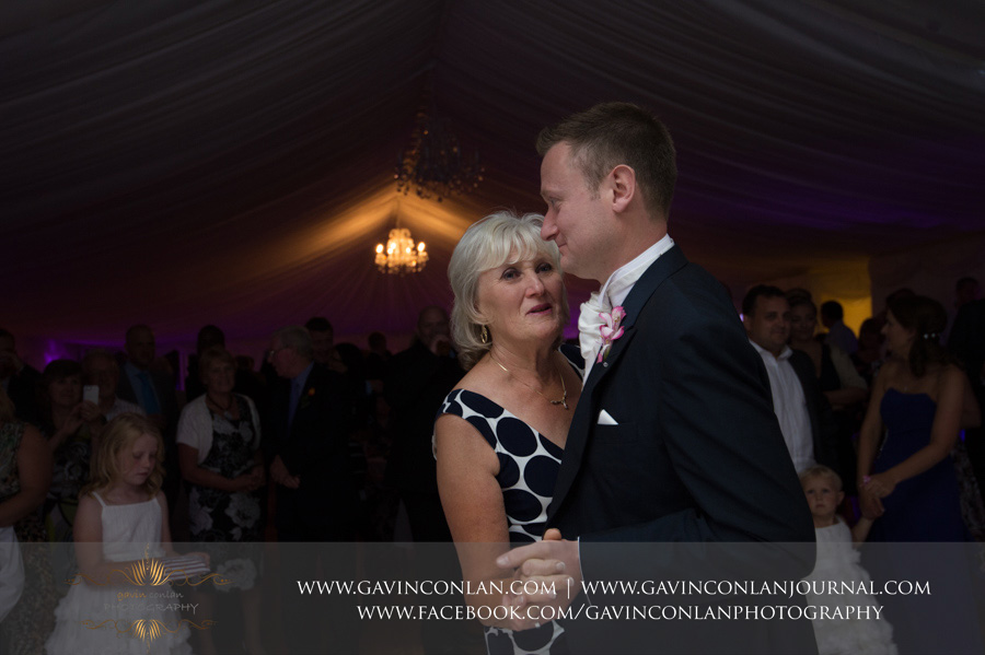groom dancing his mother dancing. Wedding photography at  Moor Hall Venue  by  gavin conlan photography Ltd