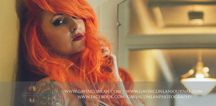 a head shot of a beautiful woman in sexy blackunderwear posing in a bathroom. Essexboudoir photographybygavin conlan photography Ltd