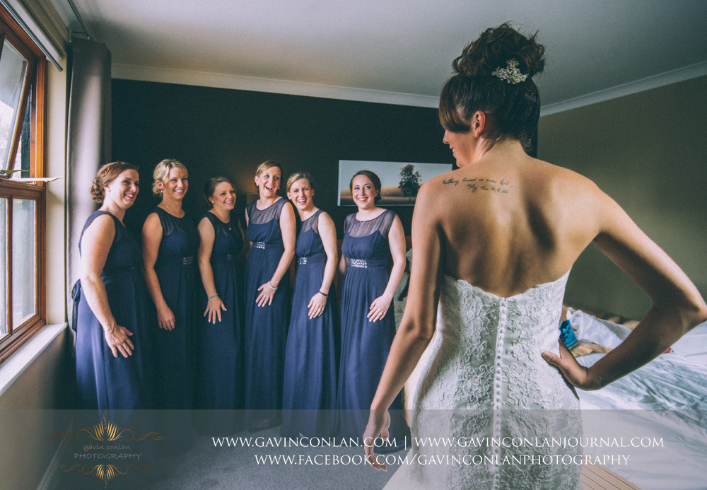 creative portrait of the bride and her bridesmaids sharing a laugh before the wedding. Wedding photography at  The Essex Golf and Country Club  by  gavin conlan photography Ltd