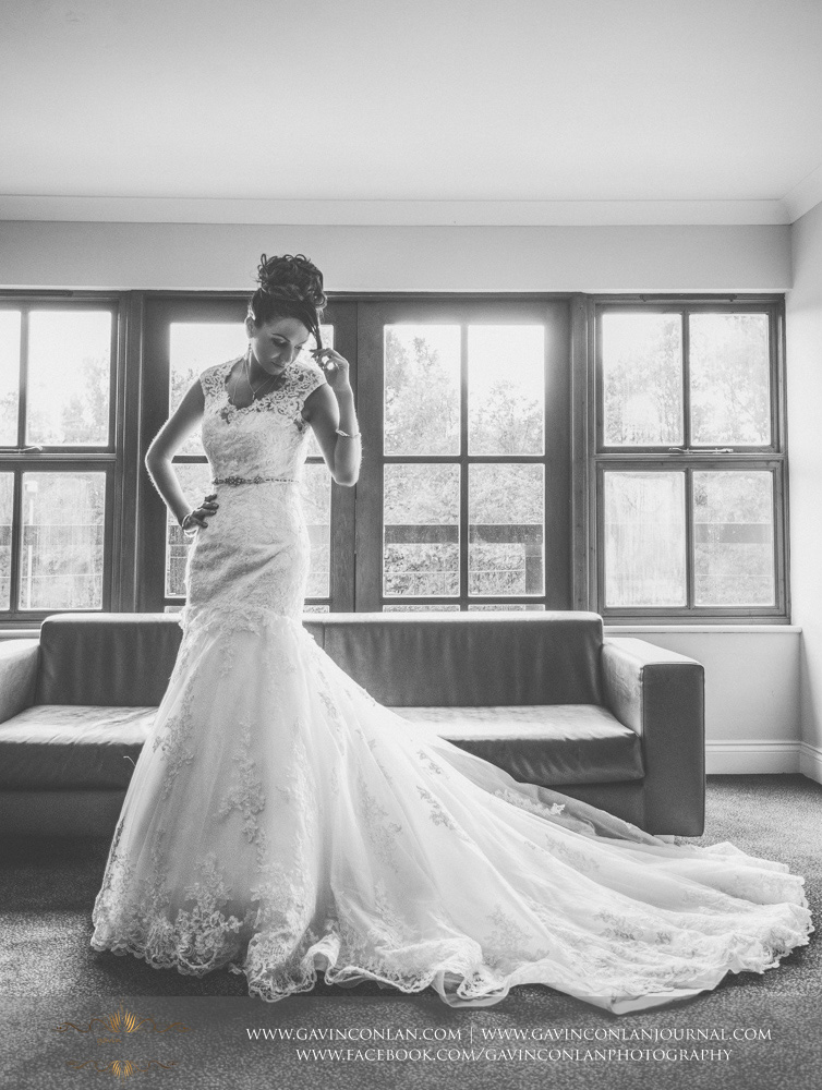 black and white full length bridal portrait. Wedding photography at  The Essex Golf and Country Club  by  gavin conlan photography Ltd