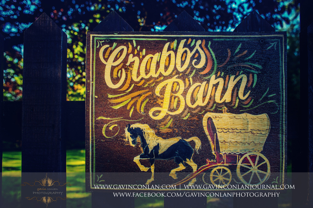 the stunning and colourful Crabbs Barn signs showcasing a horse and cart. Wedding photography at  Crabbs Barn  by  gavin conlan photography Ltd