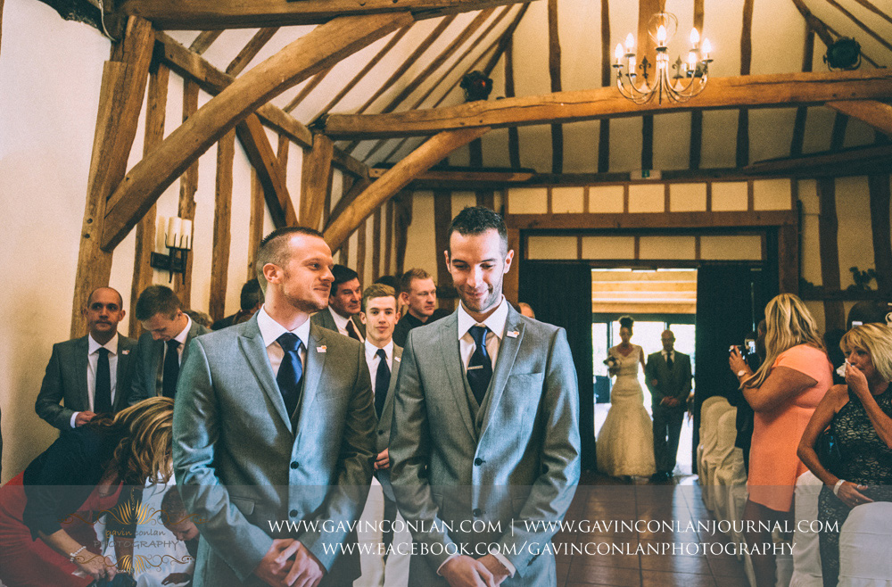 groom waiting for his bride as she begins her walk down the aisle. Wedding photography at  Crabbs Barn  by  gavin conlan photography Ltd