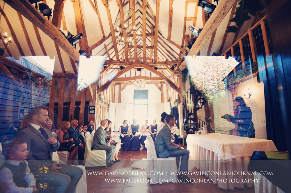 creative portrait during their wedding ceremony. Wedding photography at  Crabbs Barn  by  gavin conlan photography Ltd