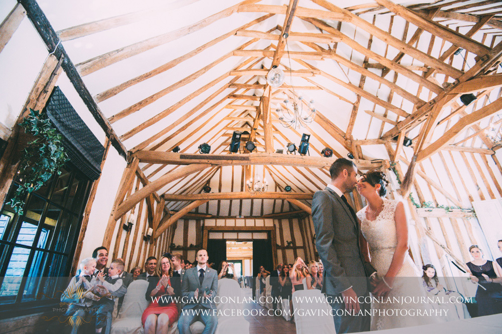 creative ceremony portrait of the bride and groom looking lovingly at each other. Wedding photography at  Crabbs Barn  by  gavin conlan photography Ltd
